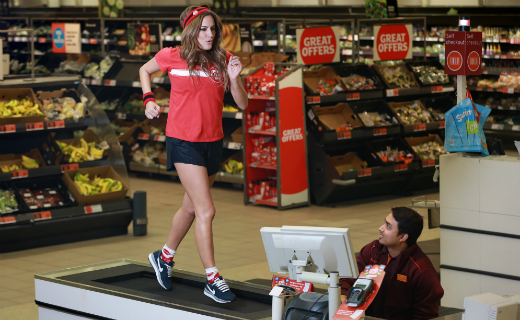 TV presenter Caroline Flack showed support for Sainsbury's Sport Relief Games by running on checkout at Sainsbury's!