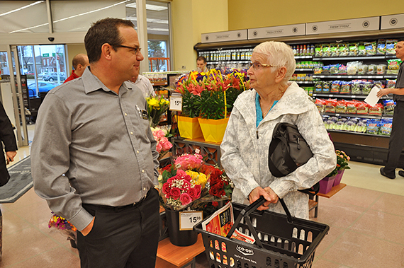 Wetaskiwin Co-op General Manager Al Halter and Muriel Hay, one of the store's first customers.