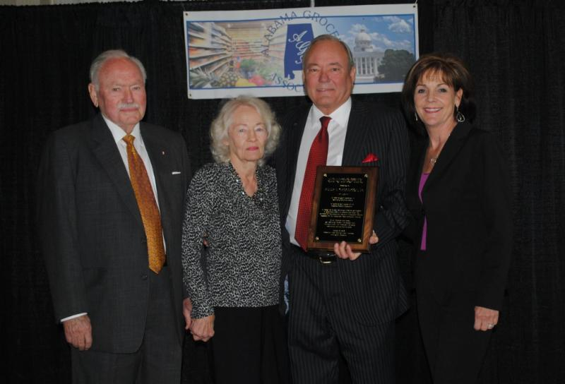 Greg Gregerson (center) is joined by his parents, Peter and Janet Gregerson, and his wife, Marcy as he accepts the NGA Spirit of America Award