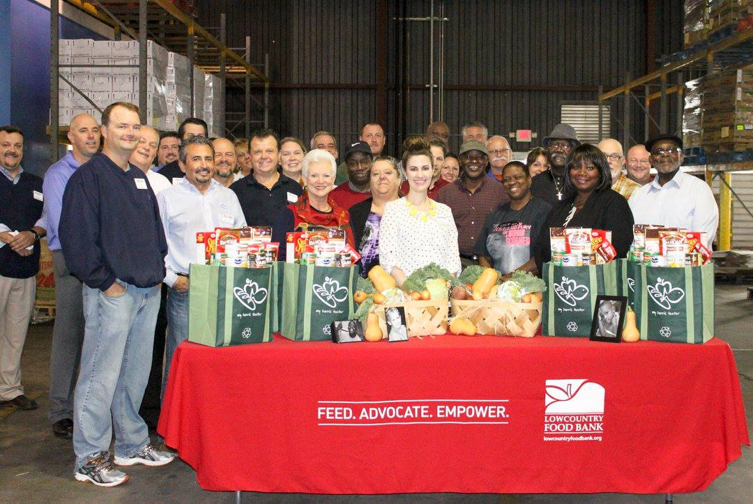 Harris Teeter and food bank volunteers gathered at the Lowcountry Food Bank in North Charleston to assemble 1,000 Thanksgiving dinner bags for families-in-need