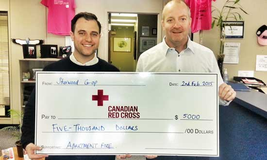 Sherwood Co-op General Manager Troy Verboom (right) presents Sherwood Co-op's $5,000 donation to Tim Johnson of the Canadian Red Cross. The $5,000 will be matched by FCL, on behalf of the CRS, as part of a $1 million commitment.