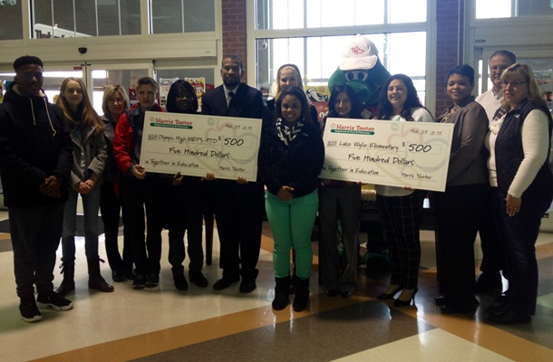 Harris Teeter presented $500 each to two local schools in support of its commitment to educational programs