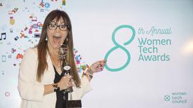 Overstock.com President Stormy Simon celebrates with her 2015 Women Tech Award.