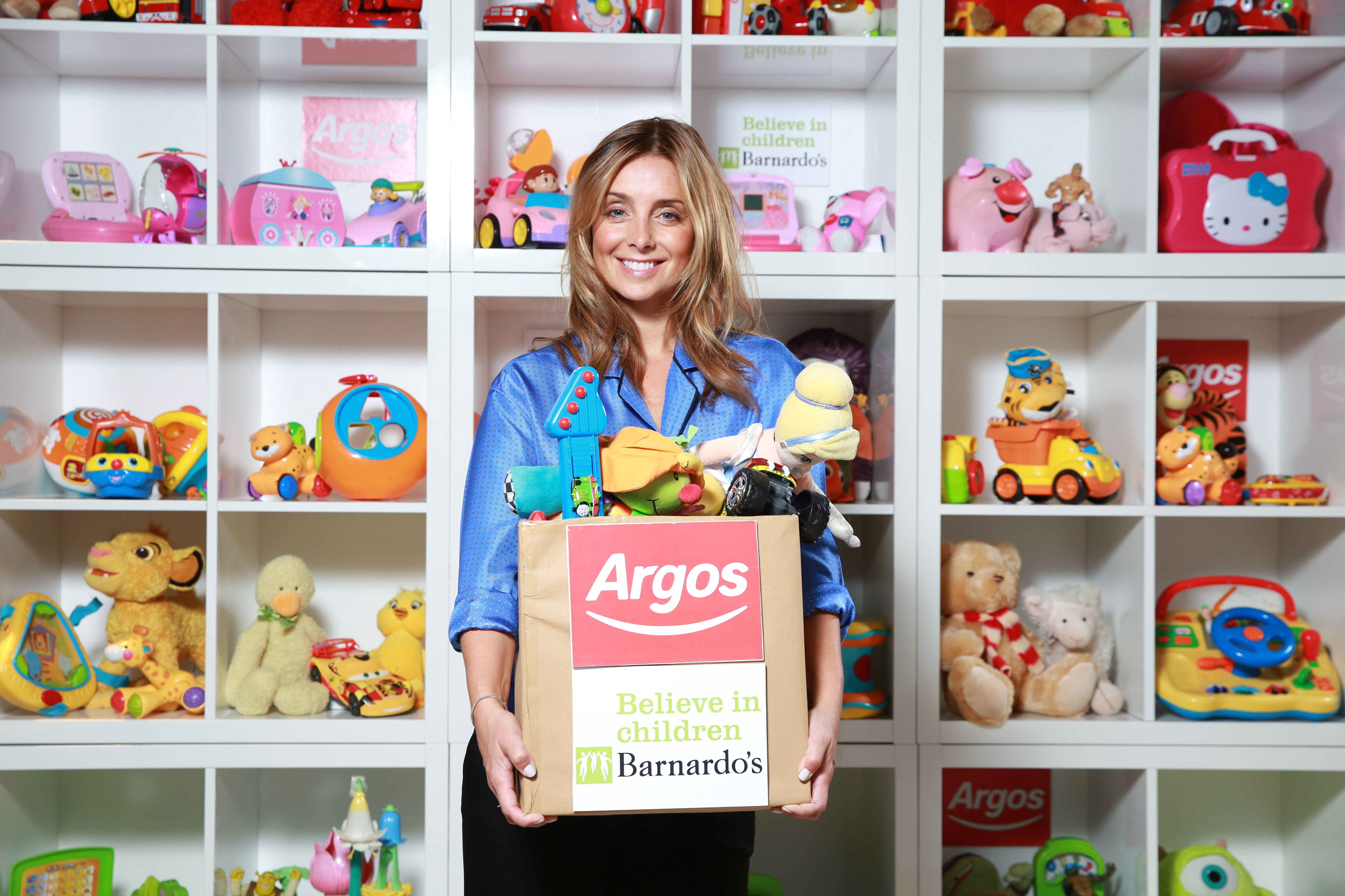 EDITORIAL USE ONLY Louise Redknapp launches the fourth annual Argos Toy Exchange, which aims to bring the amount raised by the initiative over the years to £2.5 million worth of toys for childrenÕs charity BarnardoÕs, at the Tottenham Court Road store in London. PRESS ASSOCIATION Photo. Picture date: Tuesday October 13, 2015. Photo credit should read: Matt Alexander/PA Wire