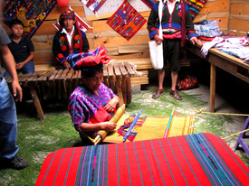 Worldstock artisan in Guatemala weaves quilt.
