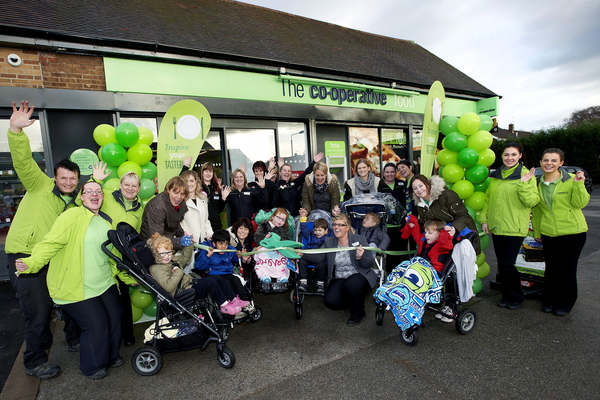 Co-Op Store opening in Retford, Nottinghamshire. Store manager, Sharleen Turner, opens the store with the help of staff and children from Willow Class, St Giles School.