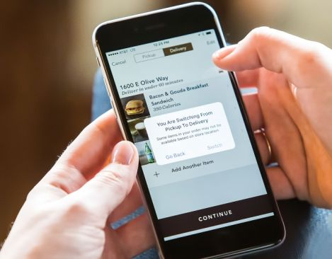 Starbucks partners with on-demand delivery service Postmates to bring delivery experience to life