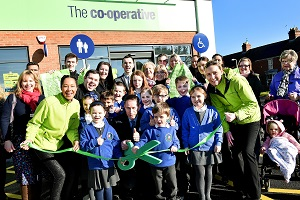 Opening of new Co-operative food store in Ancaster. Store opened by manager Stuart Wallis (in dark suit) and pupils from Ancaster C of E Primary School. Helping to cut the ribbon are Ashlee Hayter aged 10, Oscar Kerry-Dutton aged 6 and Emily Maughan aged 6.