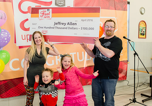 Co-op customer and member Jeffrey Allen celebrates his 2016 Fuel Up to Win grand prize with his family at the Delta Co-op Food Store in Unity, Sask.
