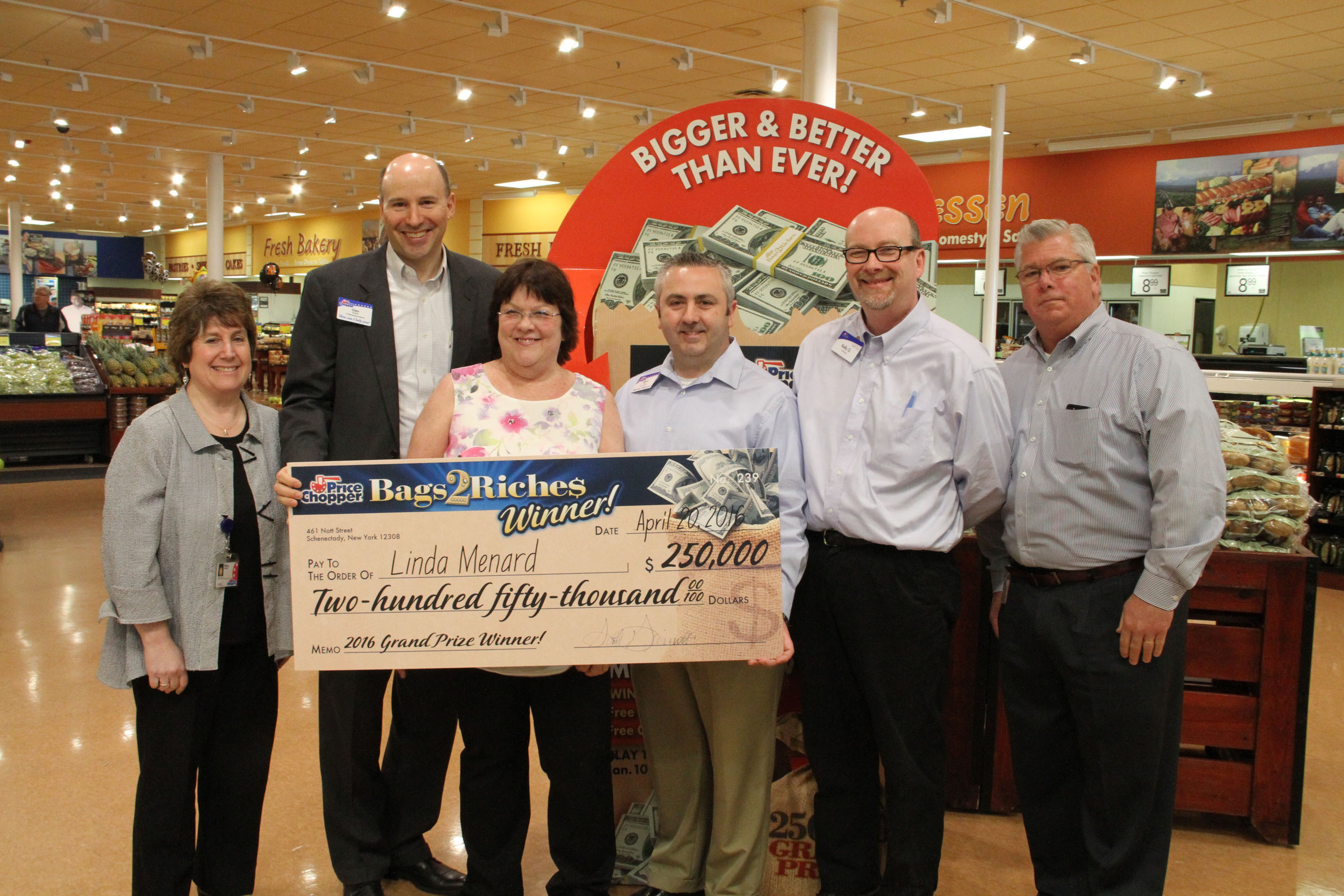Grand Prize Winner Linda Menard (white floral top) celebrates with (from left to right): Mona Golub, Golub VP of Public Relations & Consumer Services, Glen Bradley, Golub VP of Marketing Analytics, Kevin Moore, Golub Zone Director, Kelly Greene, St. Albans Price Chopper Co-Manager and Bob Hewitt, Golub Region VP.