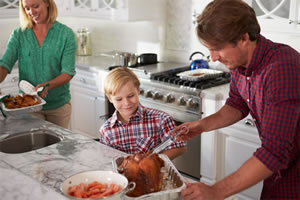 man-and-son-injecting-turkey